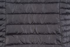 Texture down black jacket. Texture of black down jacket close up Stock Image