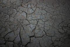 Texture of black earth, cracks on fertile land without rain. Texture of black earth royalty free stock image