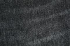 Texture of black jeans as background stock image