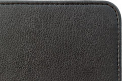 Texture of black leather product. Black leather case with a line from a thread royalty free stock photos