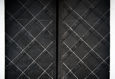 Texture of black old metal door with rivets for background Royalty Free Stock Photography