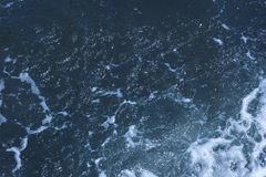 Texture of Black Sea. Blue frothy surface of sea water. Background shot of aqua sea water surface. Marine concept royalty free stock photography