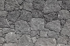 Texture of black volcanic rock wall from Lanzarote, Canary I royalty free stock photos