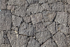 Texture of the black volcanic rock Royalty Free Stock Photos
