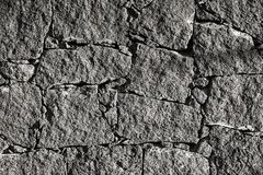 Texture of the black volcanic rock wall from Lanzarote, Canary I stock image