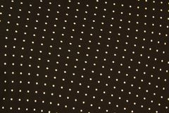 Texture of a black and white small polka dot fabric stock photography
