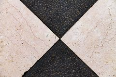 Texture of black and white stone, tiles laid out in mosaic royalty free stock images