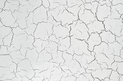 Texture blanche avec l'effet du craquelure Plâtre décoratif images libres de droits