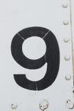 Texture blanche de fond en métal du numéro 9 vieille Photo libre de droits