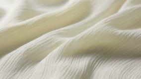Texture blanche de tissu de coton utilisé comme fond Tissu de blanc de Tighting banque de vidéos