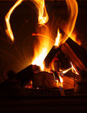 Texture of a blazing fire in the fireplace. Stock Photos