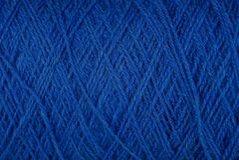 Texture bleue de fil de laine épais dans l'écheveau Photographie stock