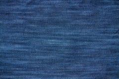 Texture bleue de jeans de denim Photos stock