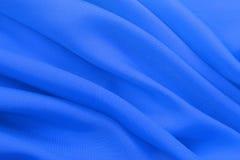 Texture bleue de tissu de couleur en pastel pour le fond et la conception, le beau modèle de la soie ou la toile Photo stock