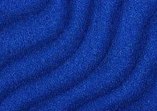 Texture bleue de vagues de sable comme fond Images stock