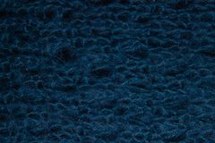 Texture of blue big knit blanket royalty free stock photography