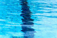 Texture.Blue clear water of the pool. Royalty Free Stock Images
