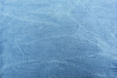 Texture of blue denim fabric close-up, space for text royalty free stock photos