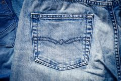 Texture of blue denim fabrics with pocket. For the background stock image