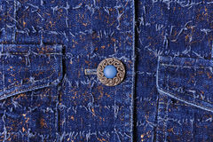 Texture of blue denim with gold threads. Beautiful blue button, pockets Royalty Free Stock Images