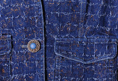 Texture of blue denim with gold threads. Beautiful blue button, pockets Royalty Free Stock Image
