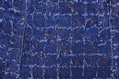 Texture of blue denim with gold threads Stock Photos