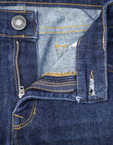 Texture of  blue denim jeans with button and zip Stock Image