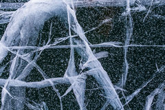 Texture of blue fairy ice of Lake Baikal with cracks and splashes. Stock Images