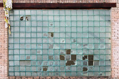 Texture of blue glass bricks with broken elements. Stock Images