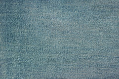 Texture of blue jeans. Fashion Stock Photos