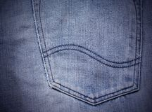 Texture of blue jeans. Back pocket textile Royalty Free Stock Photos