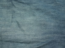 Texture of blue jeans for a background. Texture of blue jeans for background Royalty Free Stock Image