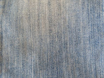 Texture. Blue jeans texture in foreground Stock Images