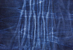Texture of blue jeans with pleats Royalty Free Stock Image