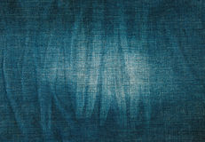 Texture of blue jeans with pleats and scuffed Royalty Free Stock Images