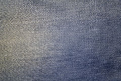 Texture of blue jeans textile Royalty Free Stock Photography