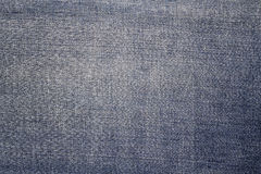 Texture of blue jeans textile Stock Images