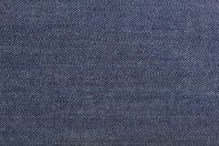 Texture of blue jeans textile Royalty Free Stock Image