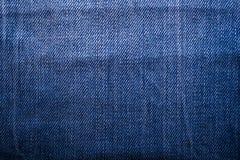 Texture of blue jeans textile close up Stock Photos