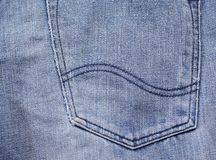 Texture of blue jeans. Back pocket background Stock Photo