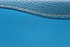 Texture of blue leatherette and sew a rounded shape. Royalty Free Stock Photography