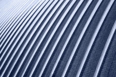 The texture of the blue metal ribbed wall. Texture blue ribbed metal walls of the hangar Stock Photography