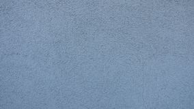 Texture of blue plastered wall for background. stock photography