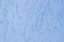 Texture of a blue putty wall. Blue roughened bumpy texture background. blue pattern royalty free stock photo