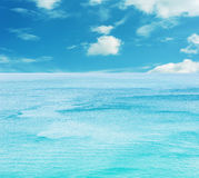Texture of blue sea water and sky. Texture of blue sea water with blue sky and white cloud for design royalty free stock images