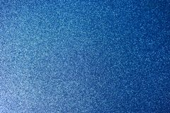 Texture of blue shiny beautiful modern shiny with silver sparkles fashionable glamorous sky color. The background royalty free stock photos