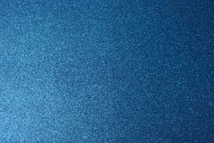 Texture of blue shiny beautiful modern shiny with silver sparkles fashionable glamorous sky color. The background royalty free stock photography