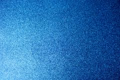 Texture of blue shiny beautiful modern shiny with silver sparkles fashionable glamorous sky color. The background stock image
