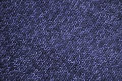 Texture of blue woven wool knitted sweater. Fabric background Royalty Free Stock Photos