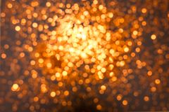 Texture of blurry gold sparkling Christmas lights. stock photos